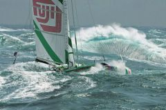 Gilles Martin-Raget immortalizes Loick Peyron's Orma 60 Fujifilm in front of a veritable wall of water.
