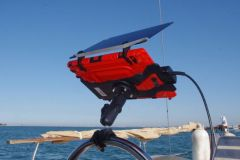 A shelf in its protection with the sun visor at the helm of a sailboat